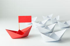 Leadership. Concept with red paper ship leading among white royalty free stock photo