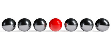 Red sphere among chrome spheres Royalty Free Stock Photography