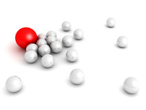 Leadership concept with red sphere and many white ones Royalty Free Stock Photos