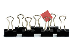 Leadership concept - row of black clips. Leadership concept - row of black paper clips with red notice isolated on white Stock Photography
