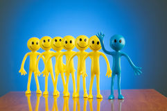 Leadership concept with smilies against background Royalty Free Stock Photography