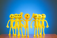 Leadership concept with smilies against background Stock Photo