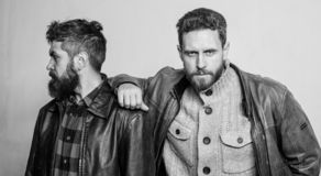 Leadership concept. True friendship of mature friends. Male friendship. Brutal bearded men wear leather jackets. Real. Men brotherhood and trust. Trust and royalty free stock photo