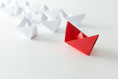 Leadership. Concept using red paper ship among white