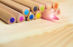 Leadership concept. Wooden colorful pencils on wooden table. Red pencil rising above other pencils. Leadership concept. Wooden colorful pencils on wooden table Stock Image