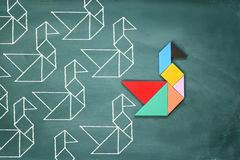 Leadership and creativity concept with tangram puzzle bird leadi Royalty Free Stock Photo