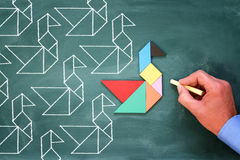 Leadership and creativity concept with tangram puzzle bird leadi Stock Photography