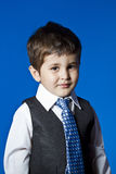 Leadership, cute little boy portrait over blue chroma background Stock Photography