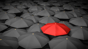 Leadership or distinction concept. Red umbrella and many black umbrellas around. 3D rendered illustration.  Royalty Free Stock Photography