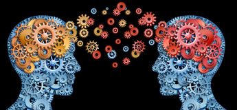 Leadership with education. Teamwork and Leadership with education symbol represented by two human heads shaped with gears with red and gold brain idea made of