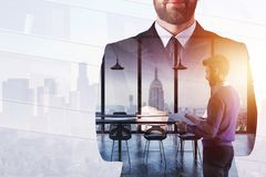 Leadership and finance concept. Businessman on abstract white office and city background with sunlight. Double exposure Royalty Free Stock Images