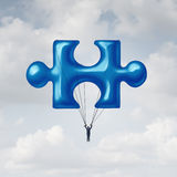 Leadership Jigsaw Puzzle. Concept as a solution metaphor with a businessman floating up to the sky with a balloon shaped as a fundamental key link unit to Royalty Free Stock Image