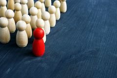 Leadership and management in business. Small figures on the desk stock photo