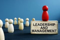 Leadership and management written on a block