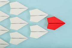 Leadership. Red paper plane leading white ones, leadership concept