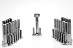 Abstract background Nuts and bolts in formation. With a clear leader royalty free illustration