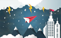Leadership success concept, Red plane flying and thunderbolt in storm over mountain go to architectural building with businessman Royalty Free Stock Photo