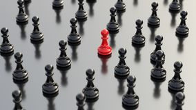 Red pawn of chess. Leadership, success, and teamwork concept, red pawn of chess, standing out from the crowd of black pawns. 3D rendering Royalty Free Stock Photos
