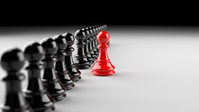 Red pawn of chess. Leadership, success, and teamwork concept, red pawn of chess, standing out from the crowd of black pawns. 3D Rendering Stock Image