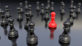 Red pawn of chess. Leadership, success, and teamwork concept, red pawn of chess, standing out from the crowd of black pawns. 3D rendering Stock Photo