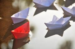 Leadership concept of team leader with paper boats royalty free stock images