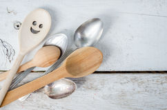Leadership, uniqueness, positivity concept. One spoon with smiley face standing with the crowd - individuality. Uniqueness, independence, think different royalty free stock photos