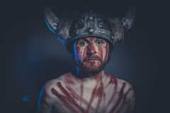 Leadership, Viking warrior with a horned helmet and war paint on Royalty Free Stock Images