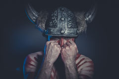 Leadership, Viking warrior with a horned helmet and war paint on Stock Photos
