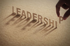 LEADERSHIP wood word on compressed board Stock Photo