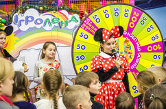 Leading actress girl dressed as a mouse in a red dress with white polka dots is a children's holiday near the wheel of fortun. LVIV, UKRAINE - JANUARY 2016 Royalty Free Stock Images