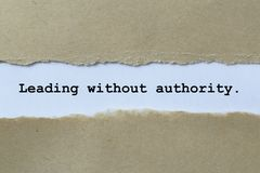 Leading without authority. On white paper stock photos