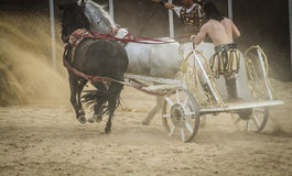 Leading, chariot race in a Roman circus, gladiators and slaves f Royalty Free Stock Photo