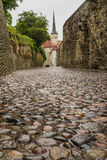 Leading down Pikk Jalg or Long Leg street, Tallinn Stock Photography