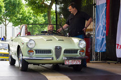 Leading exhibition takes interview driver Italian car Alfa Romeo Giulietta Spider. BERLIN, GERMANY - MAY 17, 2014: Leading exhibition takes interview driver Stock Image
