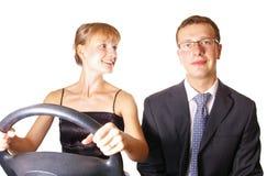 Leading girl. Leadership is depend who keeping steering-wheel Royalty Free Stock Photo