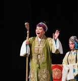 """Leading hand crutch- Beijing Opera"""" Women Generals of Yang Family"""". This opera tells a patriotic story how does an old woman of a hundred years old Stock Images"""