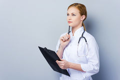 Leading an important medical documentation. Stock Photos