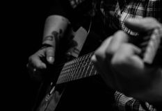Leading Lines. Black & white of a man playing guitar Royalty Free Stock Photo