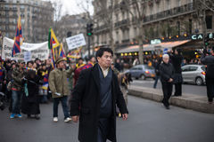 Leading the March. Representative of the Tibetan diaspora in France leading the march toward China embassy. Demonstration, Paris, March 10th, 2012 Royalty Free Stock Photo