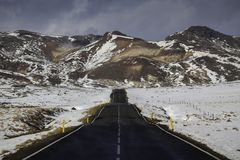 Leading road to the mountains Royalty Free Stock Image