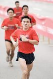 Leading runners at the nike human race. Asian runner taking the lead. this is a worldwide event held to start off at the same time singapore is the only south Stock Photos