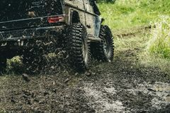 Leading up through the extreme trails. SUV or offroader on mud road. Car racing offroad. Offroad car in action. Dirty. Car drive on high speed. Car wheels on royalty free stock images