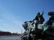 Leading You to Washington. Statue to honor Civil War Cavalrymen in DC with the Washington Monument in the background Stock Photo