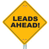 Leads. Ahead on a road sign in yellow, white background, concept of sales Royalty Free Stock Images