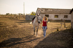 she leads a horse Stock Photos