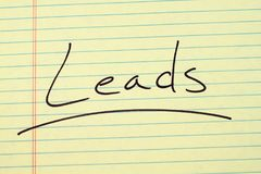 Leads On A Yellow Legal Pad. The word `Leads` underlined on a yellow legal pad Stock Photos