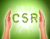 Leaf arranged in csr shape with supporting hands Royalty Free Stock Images
