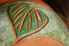 Leaf art on soil craft pot. This is leaf art on soil craft pot.this place is in east of thailand royalty free stock photography