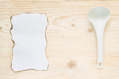 Leaf background spoon. On the table for a recipe sheet with a ladle Royalty Free Stock Image