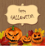 Leaf background. Vector Halloween background with scary pumpkins on wooden surface Stock Photography